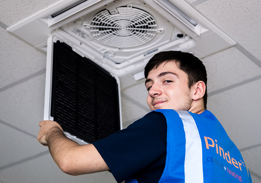 Pinder engineer installing air conditioning system