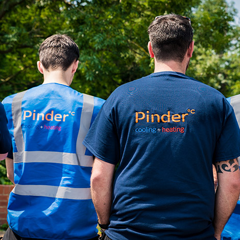 Pinder Cooling and Heating engineers in branded clothing